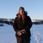 A picture of Katie Weaver standing on the frozen lake of Back Bay in Yellowknife,NWT.