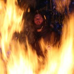 Vincent Weaver, framed in the flames of a bonefire at Duck Lake in Yellowknife, NWT.