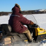 Ken Weaver rides along Great Slave Lake to reach the community of Dettah, NWT.